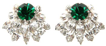 Christian Dior is one of many mainstream fashion designers who created costume jewelry for their customers. These earrings from around 1970 feature diamante and faux emerald rhinestones.