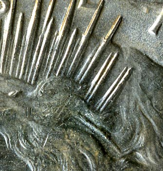 The 1934-D is one of the most readily visible and inexpensive double-die coins. This detail is of Liberty's crown.
