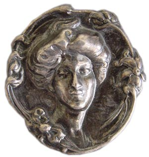 During the Art Nouveau period, Gibson Girls made appearances on jewelry, as in this silver embossed brooch.