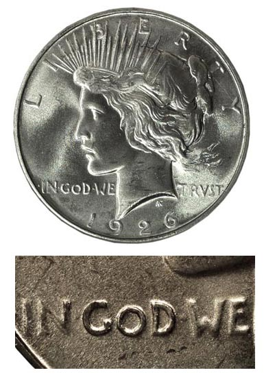 "In 1926, the Peace dollar was re-engraved to strengthen the prominence of the word ""God."""