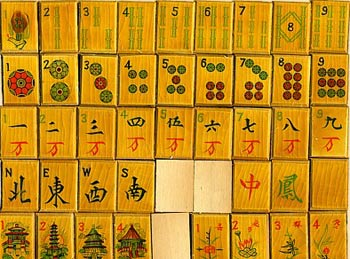 The designs on this inexpensive Pah Lukk wooden set from the 1920s are really decals that have been varnished.