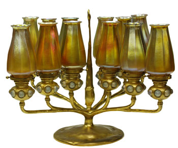 A bronze and Favrile candelabrum.