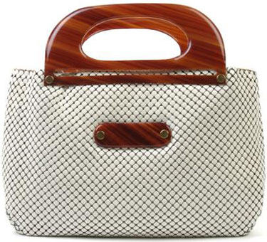 A Whiting and Davis White Mesh Purse, with tortoise resin handles, two interior pockets. Labeled: Whiting and Davis Co./Mesh Bags/Made in U.S.A.