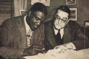 On October 23, 1945, Dodgers President Branch Rickey signed Jackie Roosevelt Robinson to the Brooklyn Dodgers, breaking major-league baseball's color barrier.