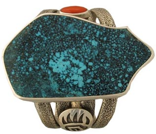 This bear bracelet by Navajo silversmith Robert Sorrell features a stunning slab of spiderweb turquoise from Arizona's Gold Canyon Mine.