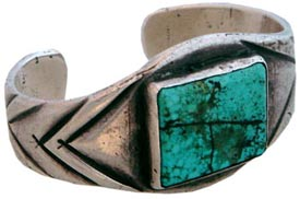 Here's a good example of Navaho chisel-work in hammered ingot silver, circa 1920. The turquoise is from Nevada.