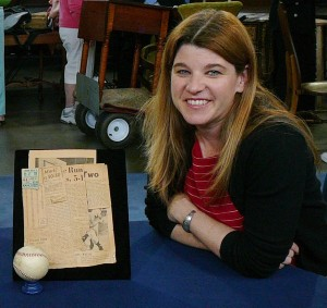 "Dunbar on the set of ""Antiques Roadshow"" with a ball signed by Babe Ruth, Mickey Mantle, and Roger Maris."
