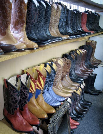 Custom boots on display at Espinoza Boot Maker in Phoenix, Arizona.