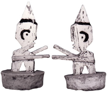 A pair of untitled wood figures, circa 1975, by Herman Bridgers (1912-1990).