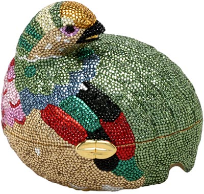 Judith Leiber is perhaps best known for her rhinestone-covered handbags, purses, and boxes, which are known as minaudieres. This one from 1980 is shaped like a grouse.