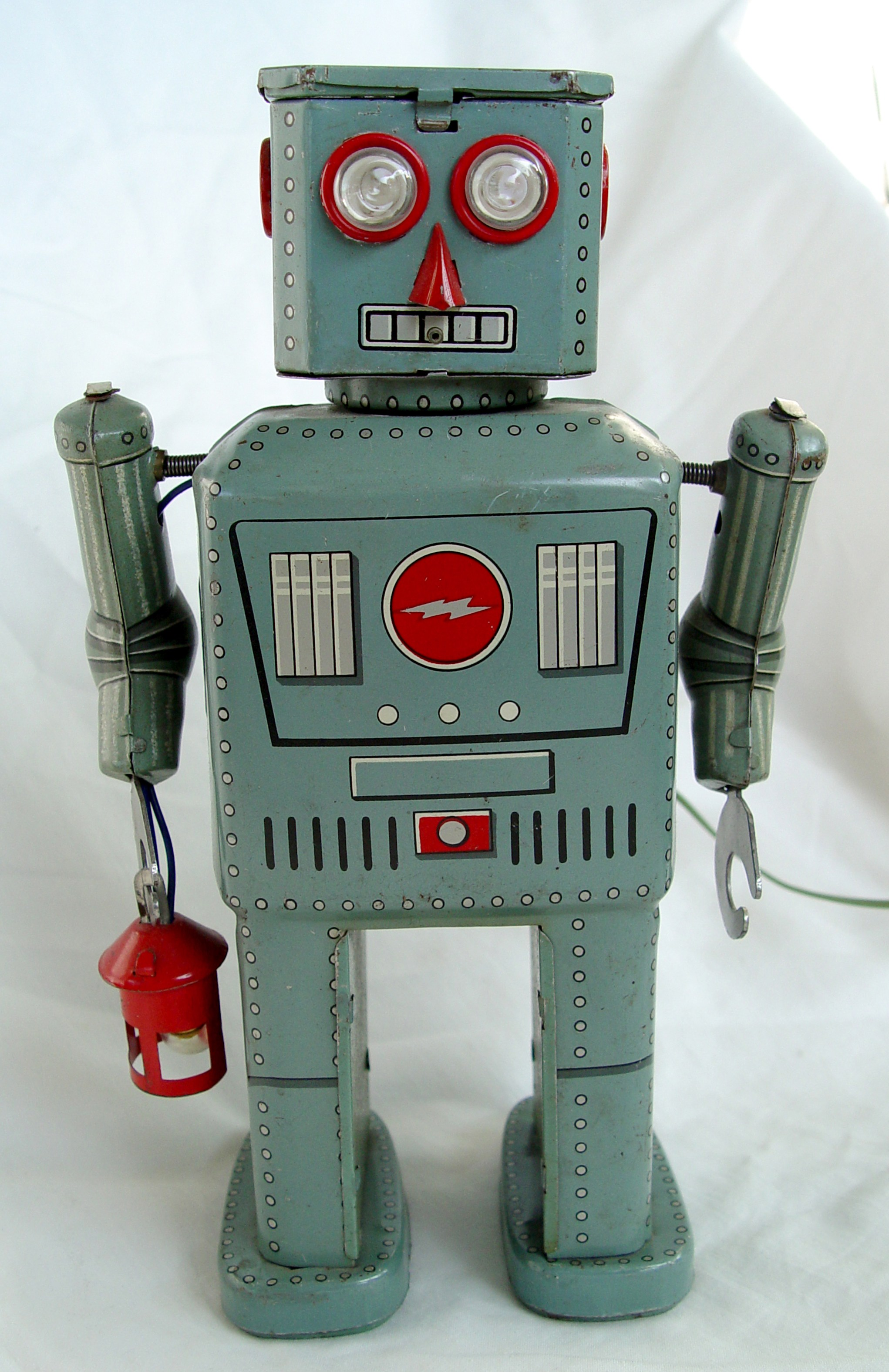 This robot carries a lantern, for which he's named, even though a robot would not need such a primitive light source to see.