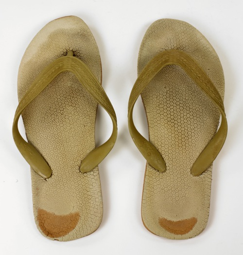 A pair of Bata flip-flops, given to the Bata Shoe Museum by their wearer, the Dalai Lama.