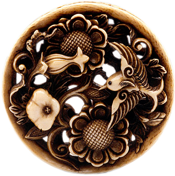 Ishikawa Rensai carved this ivory and inlaid piece depicting lotus blossoms and a bird in the mid-to-late 19th century.