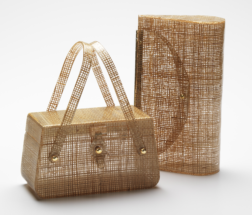 Basket-weave fabric was a favorite Lucite laminate. The bag on the left is by Charles Foster, the clutch on the right is from Wilardy.