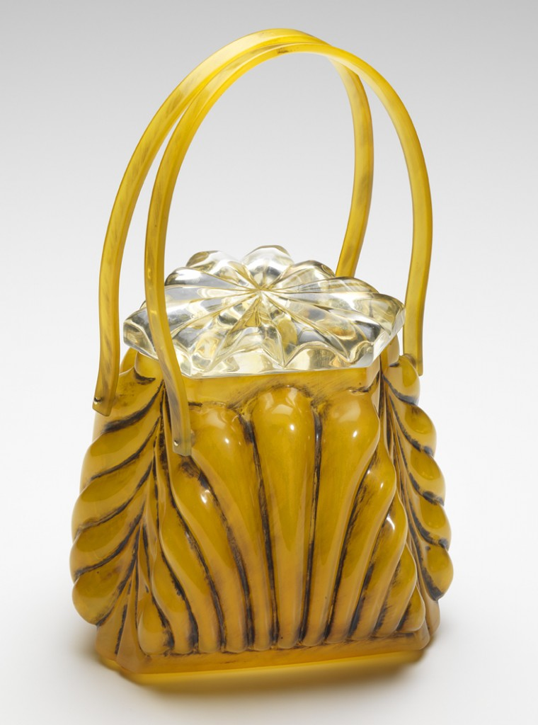 Llewellyn was known for its carved Lucite bags, as well as ones like this one made from shell, a hard plastic material composed of cellulose acetate.