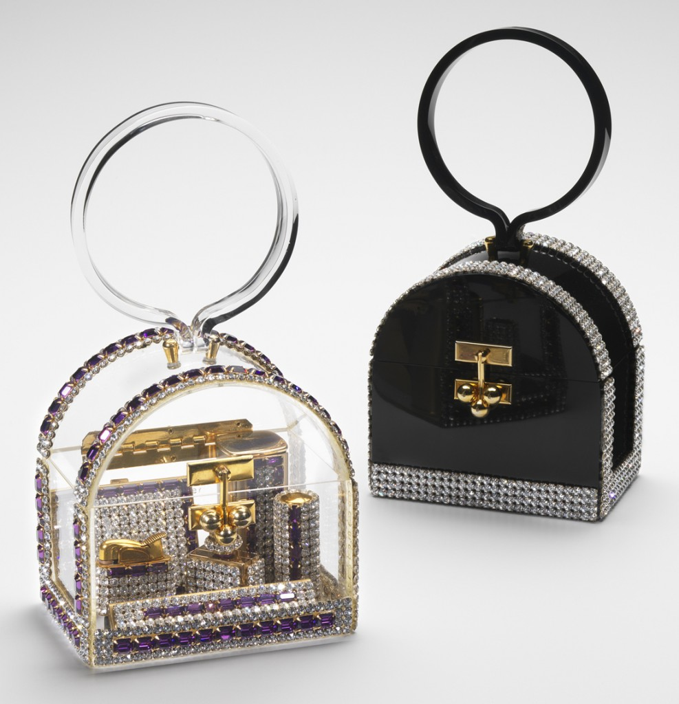 "Wiesner made rhinestone-trimmed ""birdcage"" bags in black and clear. The clear one reveals the matching accessories within."