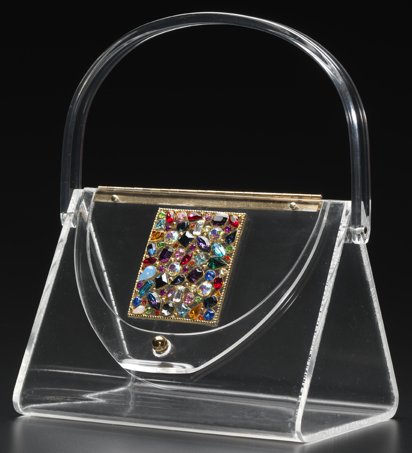 In the 1950s, women would change the appearance of their clear Lucite purses by simply changing the scarf they tossed in the bag to hide its contents from view.