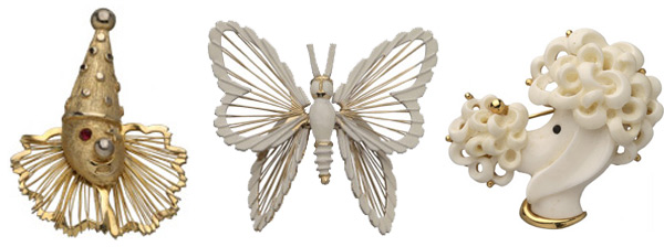 Monet figural pins include a Spinneret Clown from the early 1960s, an enameled butterfly from the early 1970s, and a resin poodle head, also from the '70s, that's accented in gold.