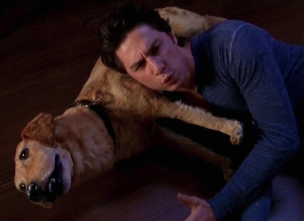 "Zach Braff cuddles with Rowdy the taxidermied dog in the TV sitcom ""Scrubs."""