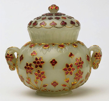 A white nephrite jade covered pot from 1650 to 1700, set with rubies in gold.
