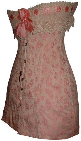 An early 1910s longline corset made from bow patterned pink brocade. From the collection of L. Hidic, corsetsandcrinolines.com, via The Antique Corset Gallery.