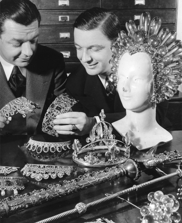 "Joseff and his brother Jimmy Glaser look at their wares. The huge acrylic headpiece was worn by Virginia Bruce in 1936's ""The Great Ziegfeld."""