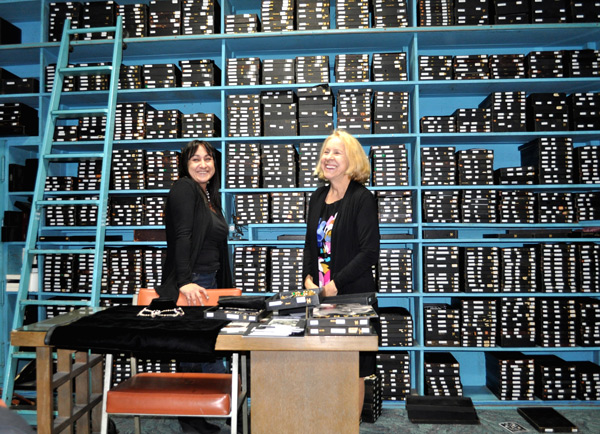 Michele (left) and Tina Joseff stand in front of trays housing thousands of famous jewelry pieces.