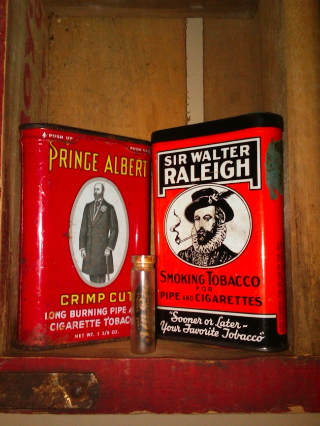 Jacob's collection of tobacco tins has a special display in his family's home.