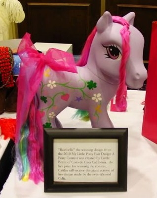 Rainbelle, a custom Pony seen at the My Little Pony Fair. A fan repainted her and rerooted her hair.