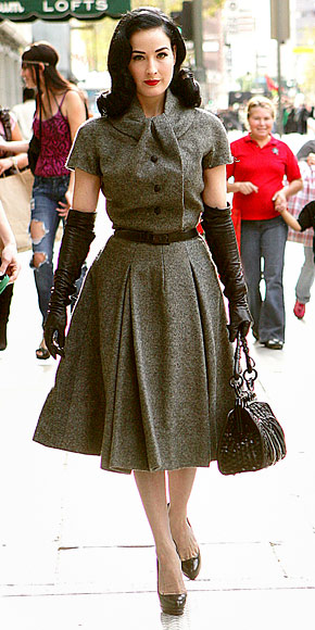 Von Teese shops in vintage Dior. Photo by Norman Scott, via InStyle.