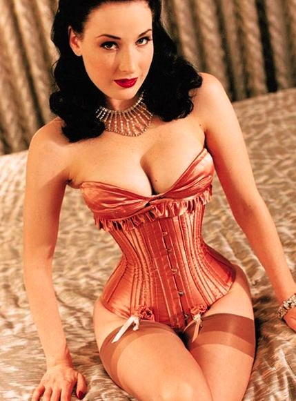 Top: Von Teese, a spokesperson for Cointreau triple sec, wears a vintage-style swimsuit in a liquor ad. Above: She wears a tight-laced corset. Photo copyright Chas Ray Krider, via MotelFetish.com.