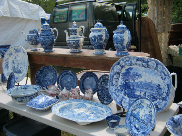 Blue-and-white transferware china on display at Brimfield. Photo by Ben Marks.