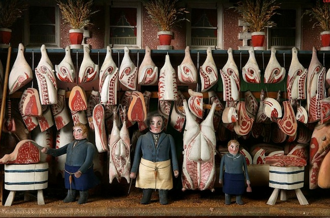 "Top: An 1840 model butcher shop, pictured in ""The World of Toys,"" even depicts the blood and sawdust on the floor. Above: The Victoria and Albert Museum has a similar model, circa 1850-'60."