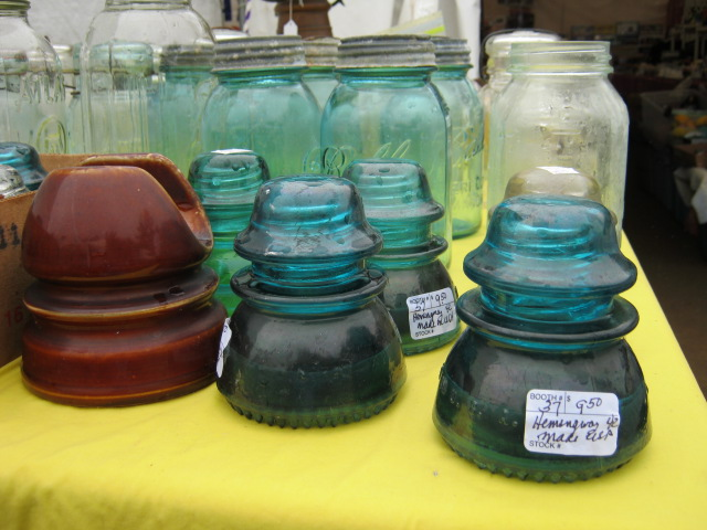 Glass insulators and Ball jars at Brimfield. Photo by Ben Marks.