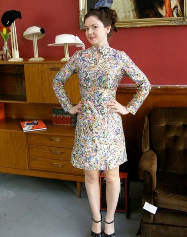 In a '60s dress, Thompson is ready to help people find the perfect hat at her Parlour pop-up shop. Via the Vintage Secret Facebook page.