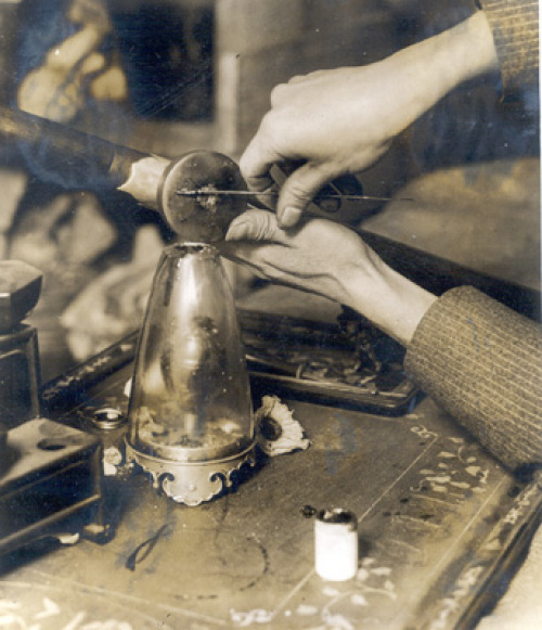 "A rare close-up photograph of an opium smoker preparing a ""pill"" of opium for the pipe. The photo is said to have been taken in New York City in the 1920s."