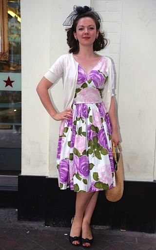 Thompson wears a '50s dress for the Liberty floral flash mob in London. Via Style Bubble.