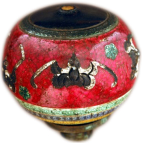 A rare pipe-bowl from the early 19th century adorned with red glaze and bats, both symbolic of happiness.