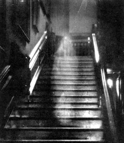 "Most antique ""spirit photos"" have been debunked, but no one can explain this 1936 photograph of the ""Brown Lady"" of Raynham Hall in England, taken by Captain Provand. Via The Haunted Museum."