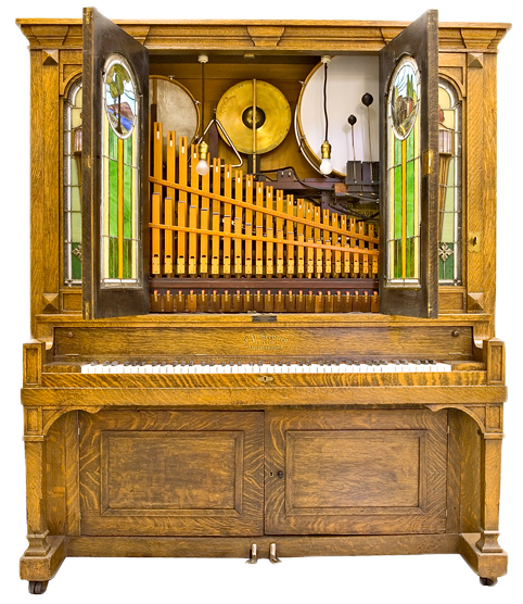 Top: Durward R. Center of Baltimore, Maryland, restored this Welte Style No. 6 Concert Orchestrion from 1895. Above: The interior of a Seeburg G orchestrion from 1913 containing a piano, mandolin, snare drum, bass drum, timpani, cymbal, triangle, and flute and violin organ pipes. Via the National Music Museum, at the University of South Dakota, Vermillion.