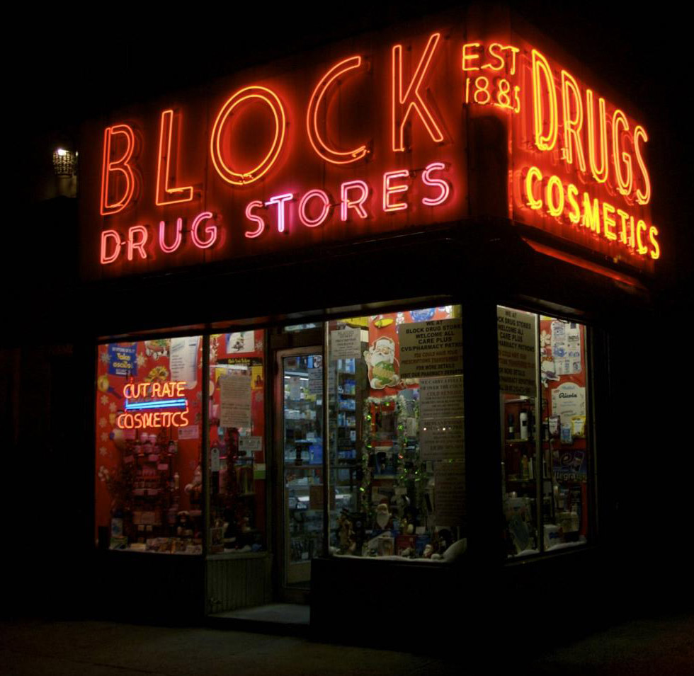 Block Drugstore in the East Village closes early, so its sign is rarely lit. Photo by Hively.