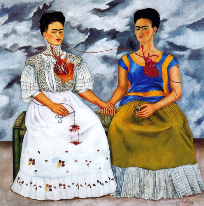 "In Kahlo's painting ""Las Dos Fridas"" from 1939, she is shown wearing both the Tehuana and European fashions, which both completely conceal her injured leg."