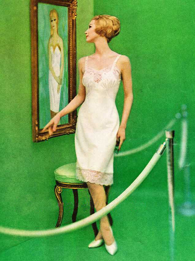 An ad for a Barbizon Satin de Lys slip with French lace and embroidery. Via CoutureAllure.com.