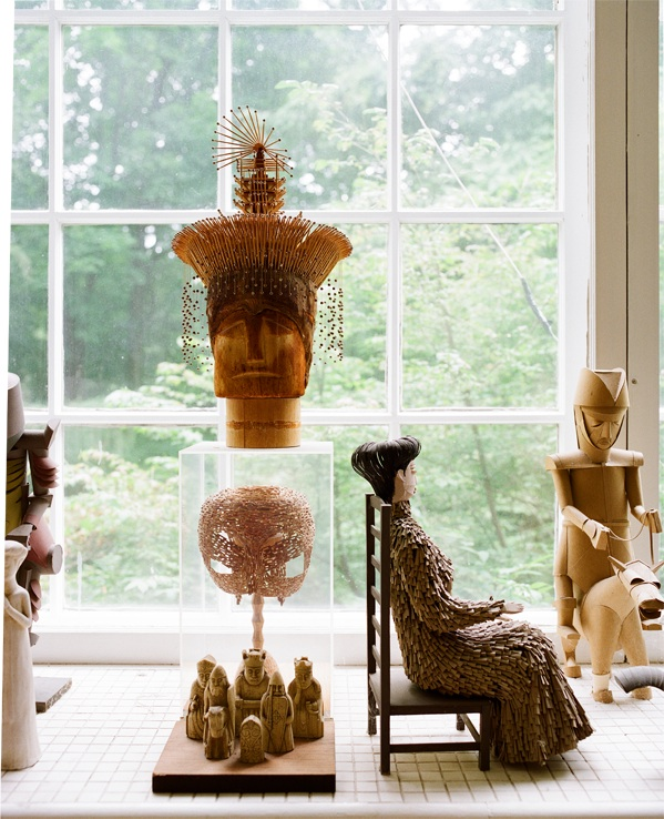 "Harper's first sculpture, a mask made of matchstick-sized pieces from window blinds, sits in a clear case on his windowsill. Photo by Leslie Williamson, from ""Irving Harper Works in Paper."""