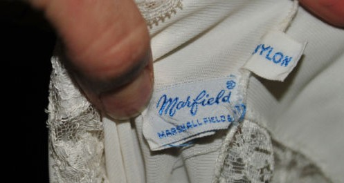The label of this vintage nylon slip by Marfield, a brand of Marshall Fields, reveals it pre-dates most FTC label requirements. Via aslipofagirl.net.