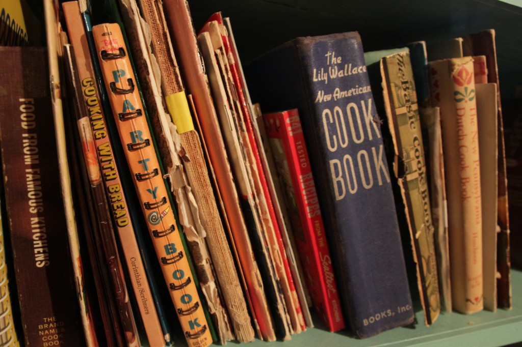 A shelf full of mid-century cookbooks from Clark's personal collection.