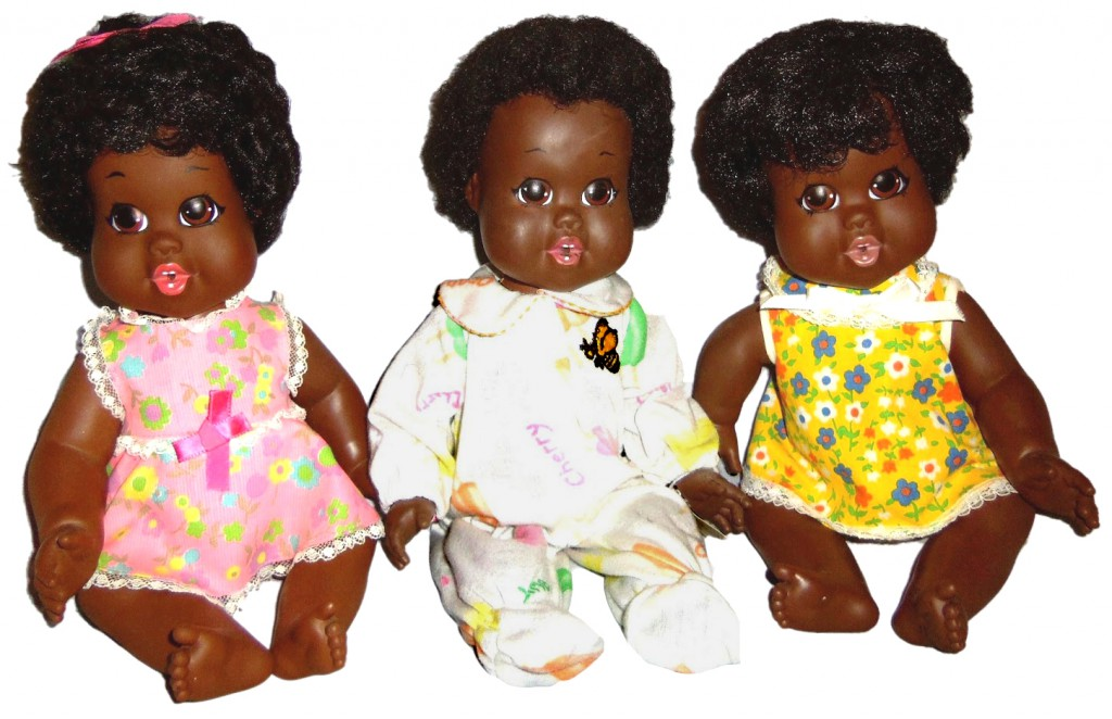 "Black Dolls?"" Above: Three Baby Nancys, the first doll produced by"
