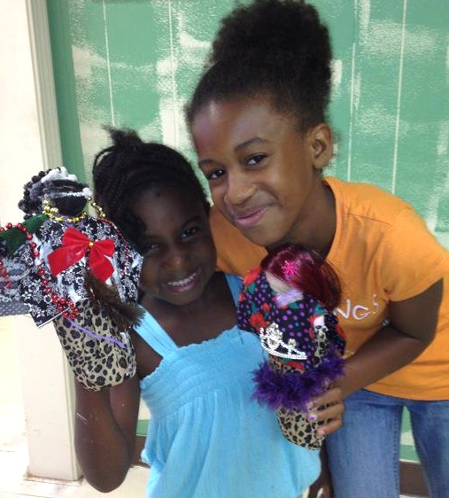 Two girls visited the National Black Doll Museum in Mansfield, Massachusetts, in August 2012 to show off the wrap dolls they made. Via the National Black Doll Museum Facebook page.