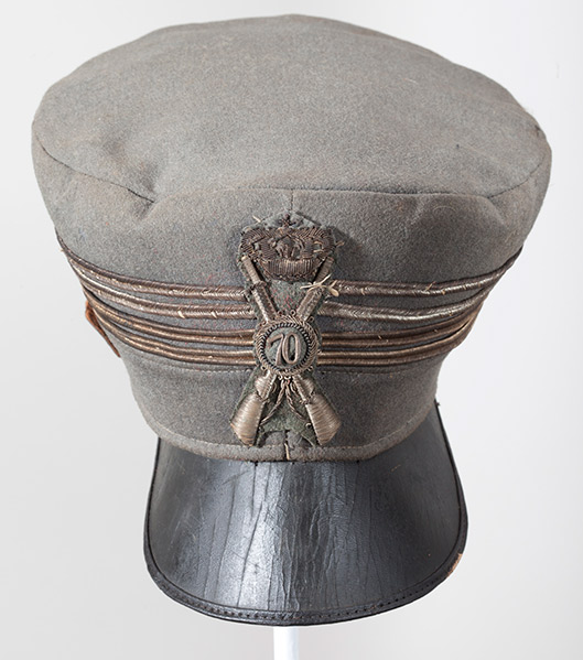 Geisel collected military hats when he was in World War II. This is an Italian line infantry officer's visor cap from the war. The insignia and number stands for the 70th Line Infantry Regiment. The four gold bands indicate the rank of colonel. (Courtesy of the Dr. Seuss Estate)