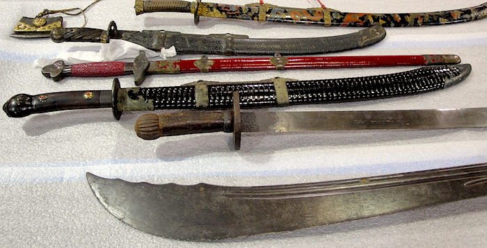 "Swords in Boyd's personal collection include several from the Yuan Dynasty (top, the red one, bottom), the ""Mongrolian"" (from the early 1200s; it's the black sword below the red one), and an unsheathed broad sword from Karakorum, Mongolia, that dates to 1500. All are included a Genghis Khan exhibition that will be in Vancouver, B.C. in August 2013."